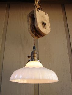I have some of these lamp fixtures but they could be Upcyled by adding pulleys.  see Vintage Farm Pulley Hanging Pendant by BenclifDesigns