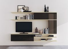 Refined and elegant composition in glossy lacquered Grey, also used for living room wall units; space where the wall is equipped with suspended elements and glossy lacquered Beige shelves