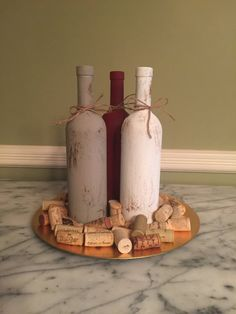 3 regular size wine bottles hand painted to create a beautiful centerpiece. Can add flowers, wine corks, place on a charger or platter or add candles to create whatever mood you are looking for. Will add to any table! *wine corks and platter not included* Please specify colors you want painted on the wine bottles when ordering. Picture one: rustic red, taupe, and cream Picture two: light purple and smokey/light grey Picture three: celery green, taupe, cream Colors: Rustic Red Rustic Oran...