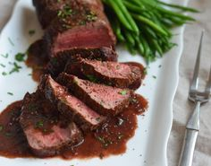 TESTED & PERFECTED RECIPE - A sear-roasted beef tenderloin with a deeply flavored, richly colored red wine sauce. A show-stopper!