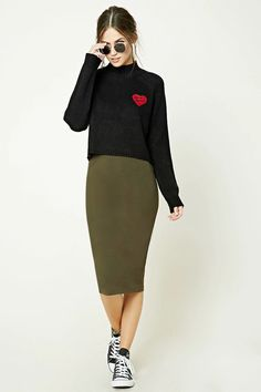A stretch knit skirt featuring a back vent and an elasticized waistband.