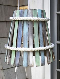 Hanging Lamp made from Paint Stirs, Knock-off bushel basket lamp