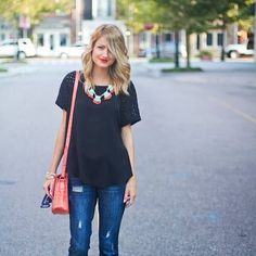 Love the bright statement necklace against, an otherwise boring outfit. This is a perfect example of wearing simple staple clothing items and styling your outfit to look amazing!  Put on a neutral top... this could be navy blue, black, white, grey, beige or brown. Pull on a pair of boyfriend jeans