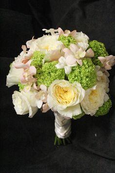 Patience garden rose by David Austin, blush dendrobium orchids, green viburnum and stephanotis wedding bouquet #GardenRoses #DavidAustinroses #pastelbridalbouquet #groheflorists