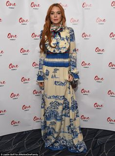 All eyes on me: Lindsay Lohan caught the eye in a striking £4,040 Gucci dress as she joined fellow guests at the Savoy Hotel ahead of the British Asian Trust's annual Iftar Ramadan event on Tuesday evening