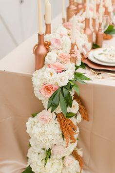 Floral table runner for a rose gold wedding