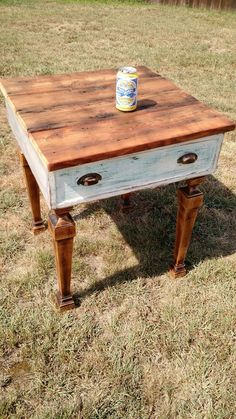 This is a handmade side table from all reclaimed materials including an old drawer.