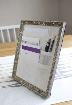 Any frame + fabric = easy desk organizer - this would be good for organizing any papers: mail, coupons, to go menus etc!