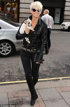 leather, blonde cropped cut, and an adorable puppy - for the rocker chic