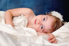 I had my little girl photographed in my wedding dress. She might not want to wear it one day, so we have these gorgeous heirloom shots to cherish!!