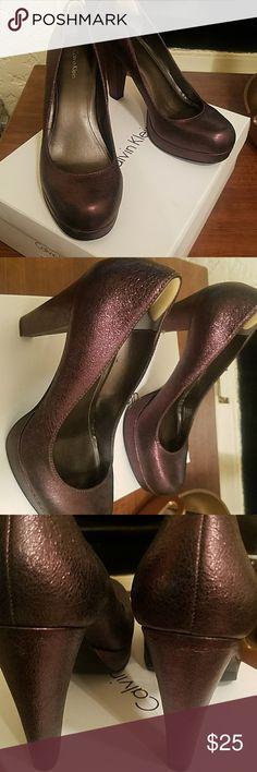 Calvin Klein pumps Metallic plum pumps worn a few times Calvin Klein Shoes Heels
