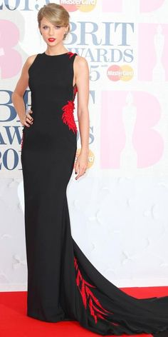 2015 Brit Awards:  Taylor Swift in Roberto Cavalli Atelier, Charlotte Olympia shoes, and Lorraine Schwartz jewels.
