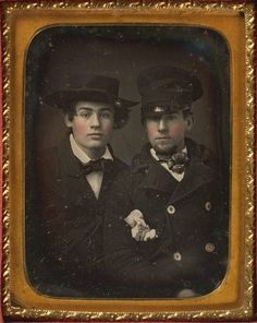 ca. 1855, [hand tinted daguerreotype portrait of two well-dressed young men wearing hats and blushed cheeks], Edward M. Tyler & Co.