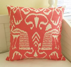 Beautiful tropical peacock China Seas design in shrimp (coral) on an ivory (almost white) background. The large design makes a statement. The