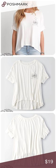 "🆕 AEO graphic top NEW with tags, never worn and in excellent condition. white, soft, comfortable top.   details ∙ medium ∙ 22"" front / 26"" back in length ∙ 24"" bust  ∙ 8"" sleeves  due to lighting- color of actual item may vary slightly from photos.  please don't hesitate to ask questions. happy POSHing 😊  💰 use offer feature to negotiate price 🚫 i do not trade or take any transactions off poshmark American Eagle Outfitters Tops Tees - Short Sleeve"