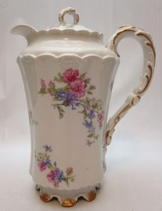 Beautiful Haviland Limoges Lidded Coffee Pot c. 1894 - 1932 decorated with pink flowers and smaller blue blossoms with gold trim on handle, lid finial and base. The coffee pot is in excellent conditio