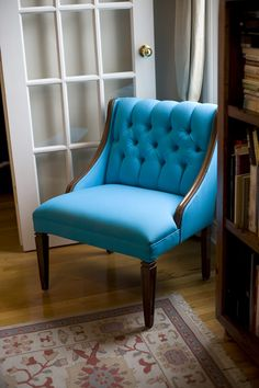 reupholstered turquoise chair