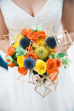 Colorful wedding bouquet, fun geometric shapes, bright yellow and orange roses, modern wedding // Jennie Karges Photography
