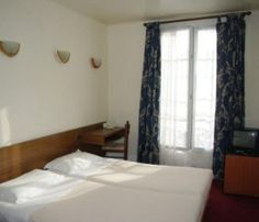 Paris, Hôtel Roi René - Hotel du Roi Rene is conveniently located in the popular 17th - Arc de Triomphe - Palais des Congres area. Featuring a complete list of amenities, guests will find their stay at the property a comfortable one.