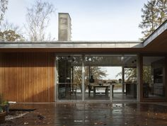 Energy-efficient, pine-clad Danish home is heated with geother...