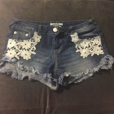 floral decorated jeans shorts blue jeans shorts, size 5, floral pattern on the front. Mossimo Supply Co Shorts Jean Shorts