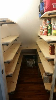 """Industrial pantry shelving under the stairs. 3/4"""" Galvanized pipe, flanges and caps. Turned our closet into TONS of useful storage. 12"""" deep on right, 10"""" deep on left."""