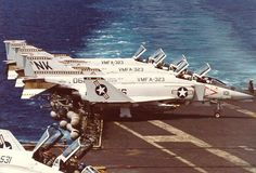 """The USS Coral Sea deck with McDonnell F-4N Phantom II of the US Marine Corps Squadron fighter-bomber VMFA-323 """" Death Rattlers"""". Circa 1979-80"""