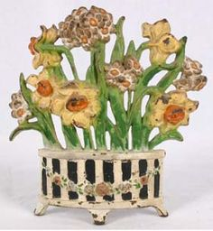 """Charming Victorian painted cast iron floral planter doorstop with jonquils.  Impressed #266?.  7 1/4\""""H x 7 1/4\""""W.  No apparent damage or repairs.  See photos for further condition."""