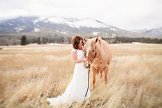 In an idyllic setting with the horse & the mountains....awww...