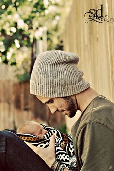 Men and babies! I don't think a man could look any more of a man than when he is holding his child<3