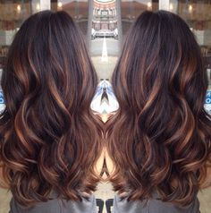 Dark brown with golden Carmel highlights.  I like the high and low lights.