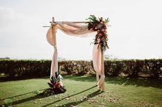 Maui wedding with a protea-adorned ceremony arch
