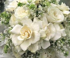 White bridal bouquet of gardenias and lilacs.