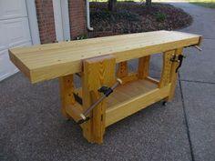 Front view of bench showing arrangement of leg vise, sliding deadmen( front and back), end vise, and bottom shelf - CLICK TO ENLARGE