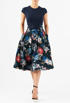 A vintage silhouette goes modern with our color-blocked dress, styled with a round neck cotton knit bodice and a box-pleat floral print skirt for feminine whimsy and movement.