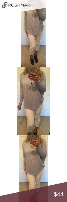 Solid Waist Length Long Sleeve Top 49% Rayon 47% Polyester 4% Spandex. Relaxed style with V neck and zipper. Denim blue. Modeling Small. Tops Tees - Long Sleeve