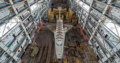 Russian space shuttles sit forever unused at the Baikonur Cosmodrome, gathering dust.