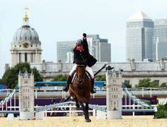 Peter Charles on Vindicat clinching the Olympic team gold medal for Great Britain in a jumpoff with the Netherlands.