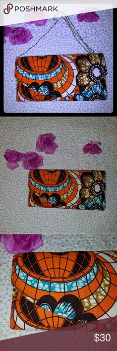 NWOT, Beautiful African Print Envelope Clutch Beautiful African Material, chain strap, 13 inches wide, 7 inches tall, vibrant orange, blue, Brown, white and gold, lots of room inside African Bags Clutches & Wristlets