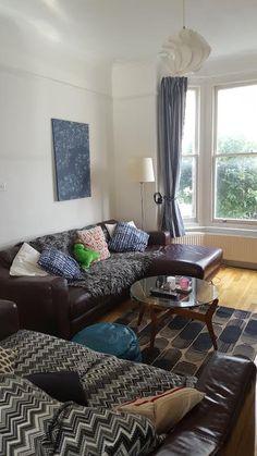 Living room. Dulux Timeless walls, Habitat and H&M cushions, Habitat rug, vintage 70s coffee table.