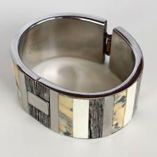 Silver tone bangle bracelet with inlayed genuine stones, signed PONO ... Lot 171