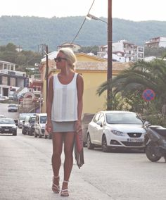 So stylish. So tan. So not concerned with the approaching car.
