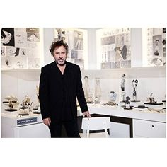 Tim Burton in Studio with Concepts Models and Sketches Smiling 8 x 10 Photo