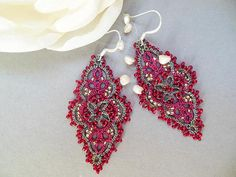 Tatted drop or dangle earrings in two thread and two beads color. Lightweight filigree pierced ear statement jewelry create a delicate accent for any occasion. Using the French technique and a small tatting shuttle, I create intricate designs of beads tatted onto strong multi-color