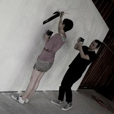 My sister Ceci painting Cuchara's mural while Simon Gentry documents!