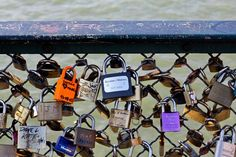 Love locks on the Pont des Arts. Attach a love lock then throw the key into the Seine. C'est romantique.