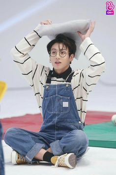 Awe Jungkook look at his big eyes and his clear skin ans cute overalls like from the fashion runway episode he's so adorable ❤️