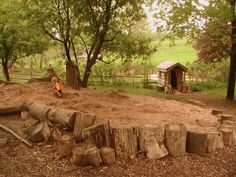 Natural playground; massive sand pit framed by logs; Kimberton Waldorf School, Pennsylvania