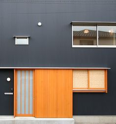 Urban Architecture Grey beauty with #Tangerine #Tango front door
