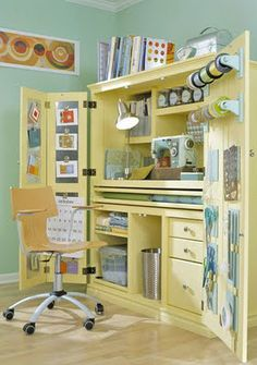 Organized craft space in an armoire.